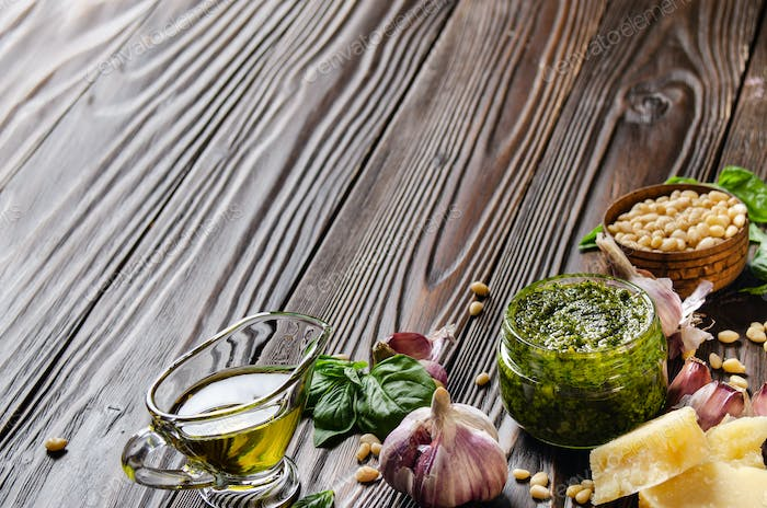 Food background of genovese pesto sauce and its ingredients. Space for text