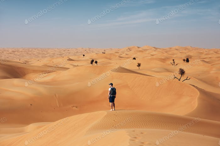 Man in the middle of desert