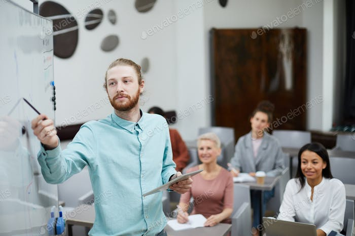 IT Teacher Pointing at Board