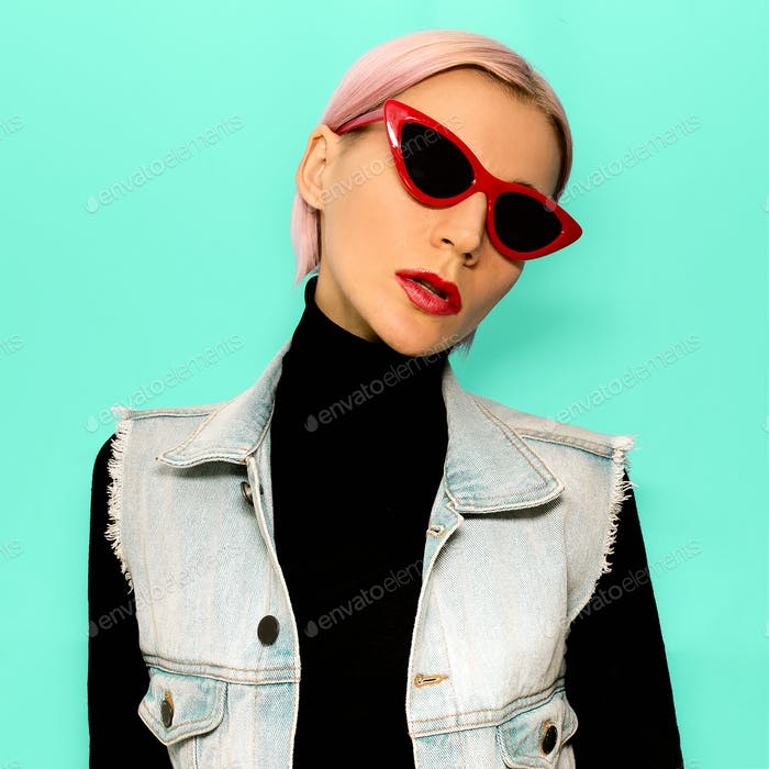 Blonde girl in fashionable clothes and trendy sunglasses. Stylis