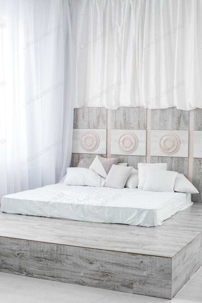 Big light bedroom with a bed. Concept interior, dream, lifestyle