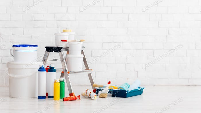 Painting accessories, equipment in empty room, panorama
