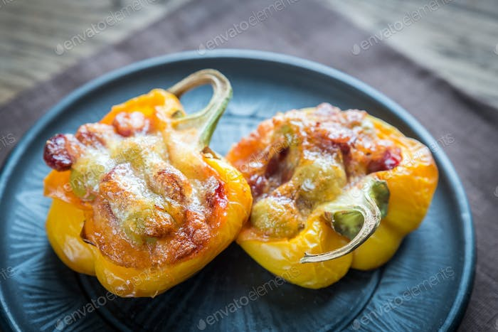 Stuffed peppers with sausages and mozzarella topping