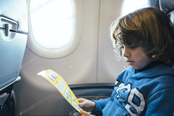 Child reads the safety airplane card