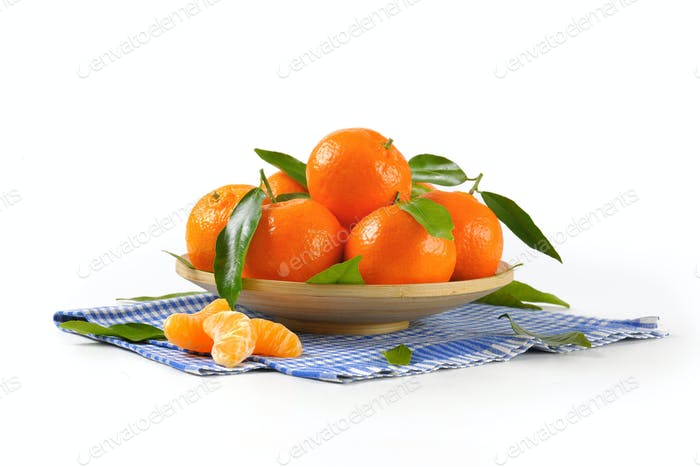 plate of ripe tangerines