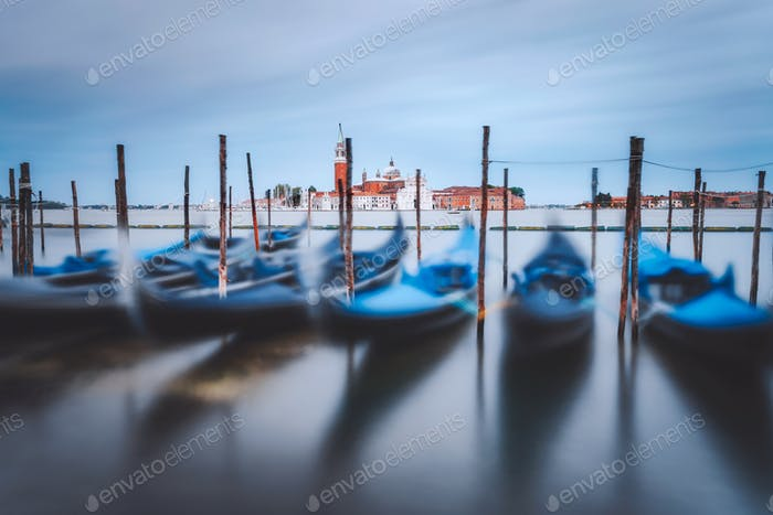 Gondolas floating in the Grand Canal in front of San Giorgio Maggiore church in background. Long