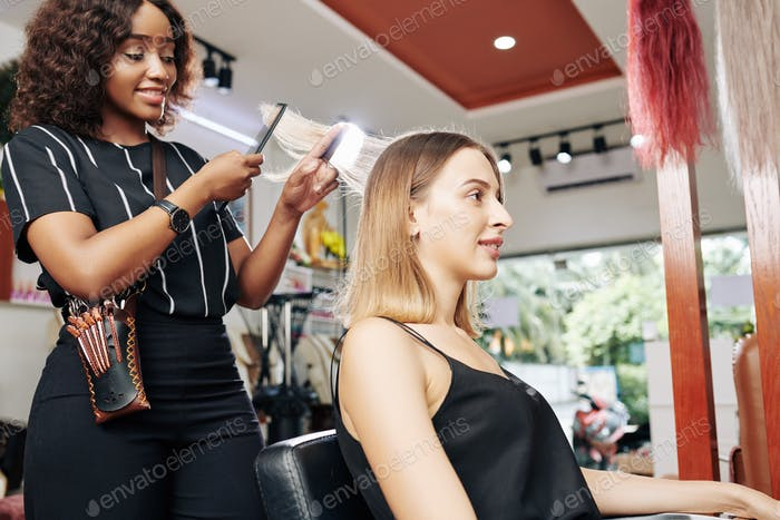 Young woman having her hair done