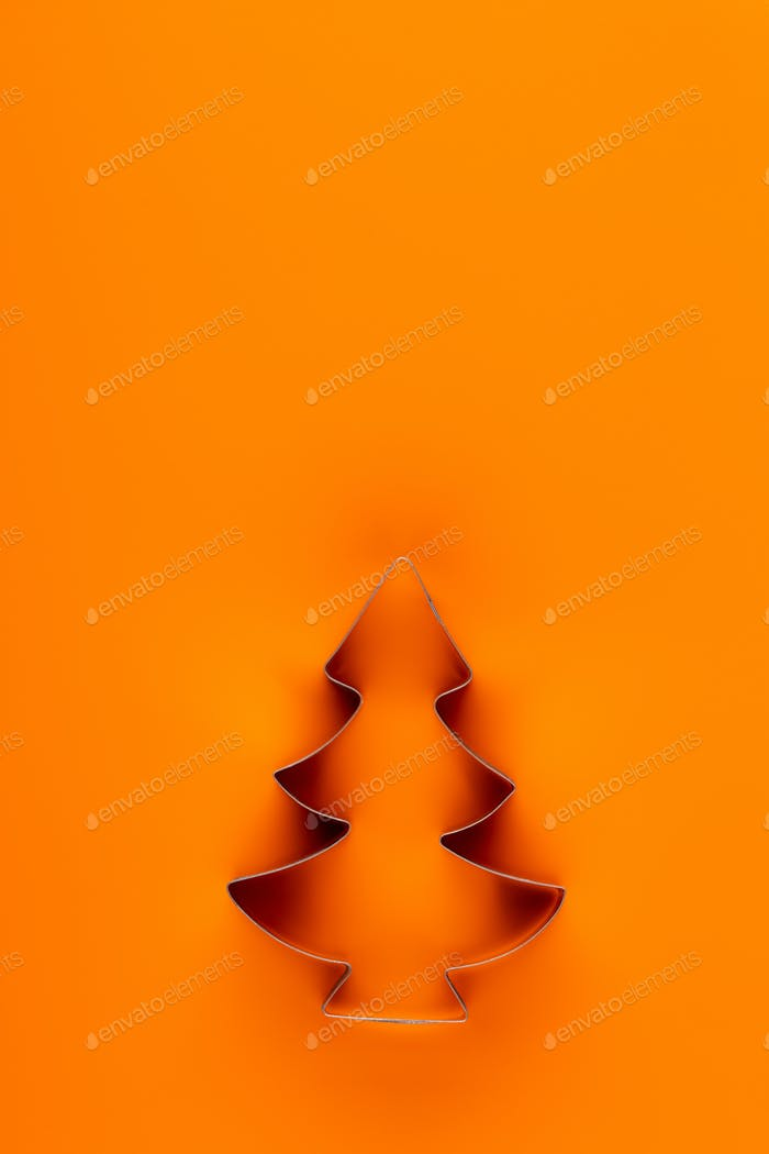 Christmas decoration, fir tree on orange background.