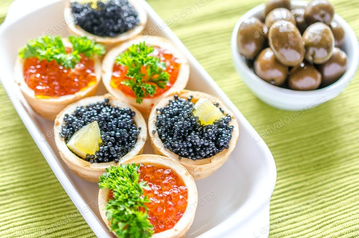 Tartlets with black and red caviar