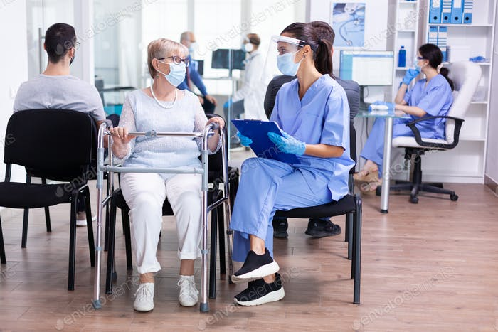Nurse wearing protection visor