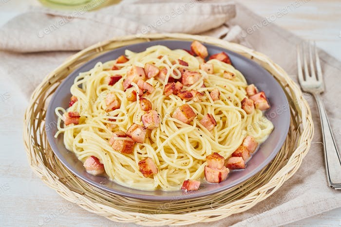 Carbonara pasta. Spaghetti with pancetta, egg, parmesan cheese and cream sauce
