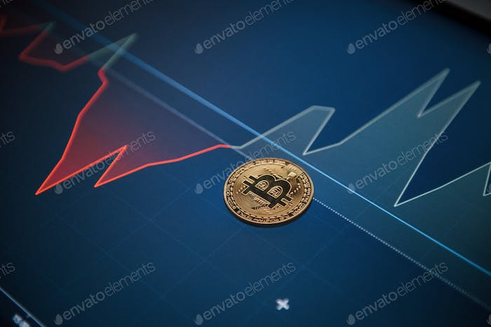 Modern digital currency. Picture of golden bitcoin lying on the display with graphs in office