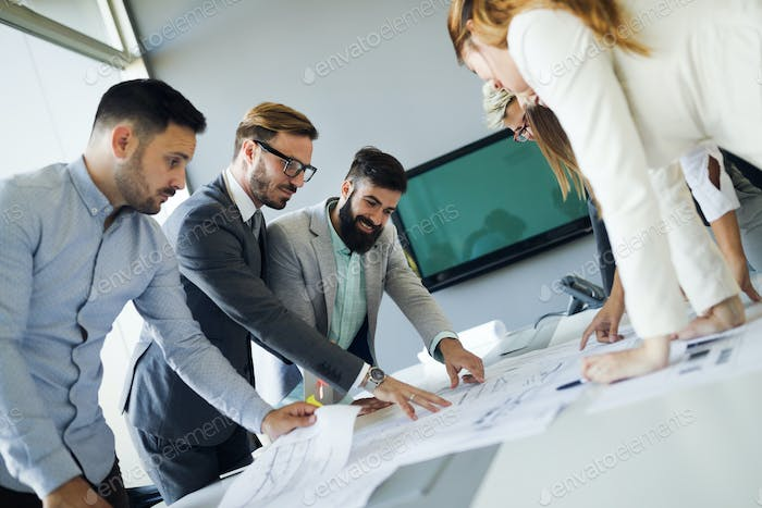 Picture of young architects discussing about project