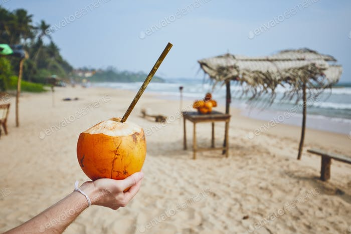 Coconut with bamboo straw