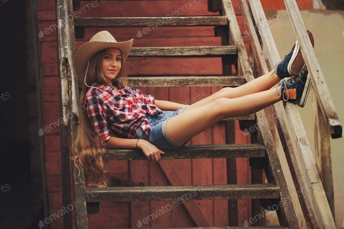 beautiful young cowgirl with long hair