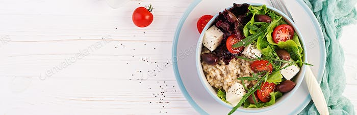 Vegan salad. Breakfast bowl with oatmeal, tomatoes, cheese, lett