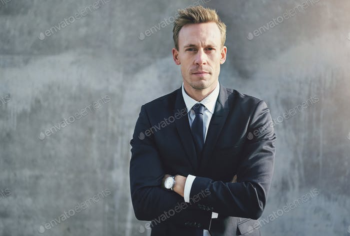 Handsome man in suit with arms crossed