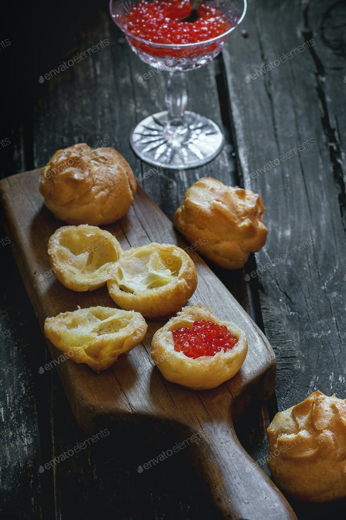 Profiteroles with red caviar