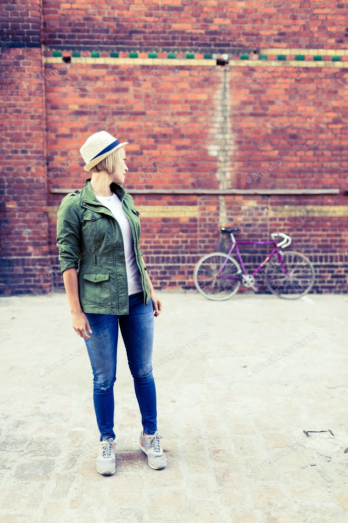 Hipster girl and vintage road bike in city