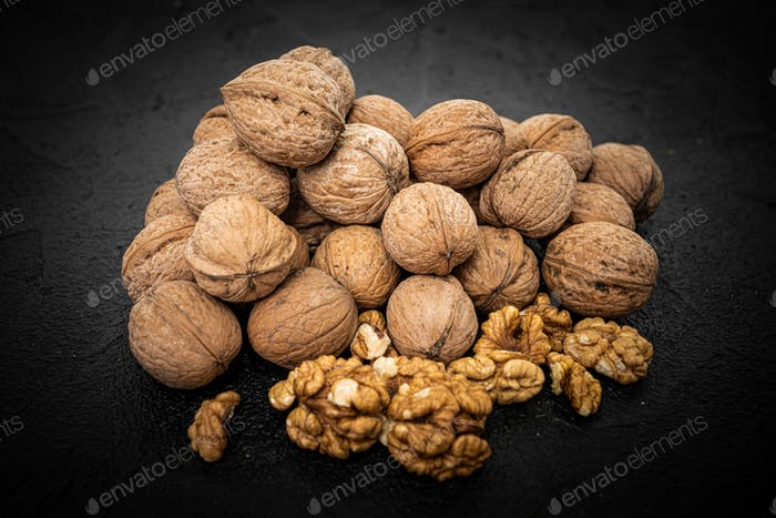 Walnuts on black background. Group walnuts on Healthy organic food concept.