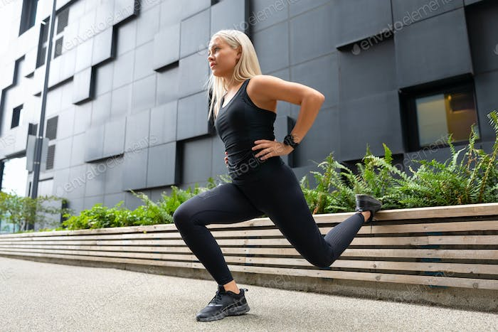 Close-up of Fit Woman Performing Lunge Workout Outdoor in the City