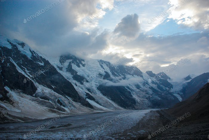 Scenic Landscape With Snowy Mountains and Cloudy Sky, Russia, Caucasus