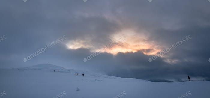 People walking towards Storsteinen mountain summit