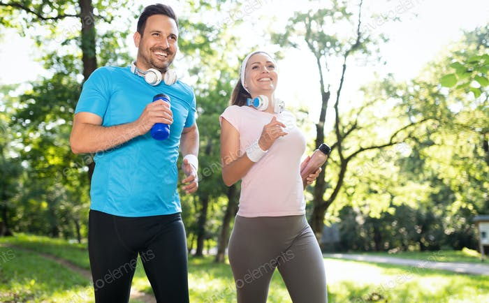 Happy couple running and exercising together outdoor