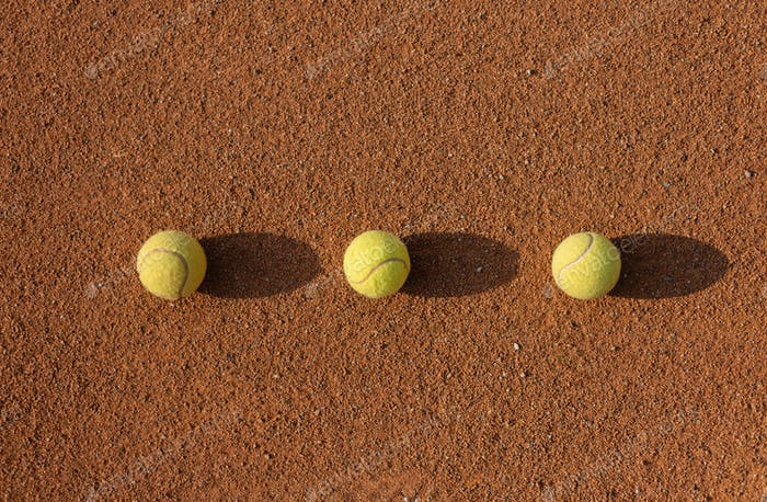 Tennis ball on the court. Sports equipment for active lifestyle