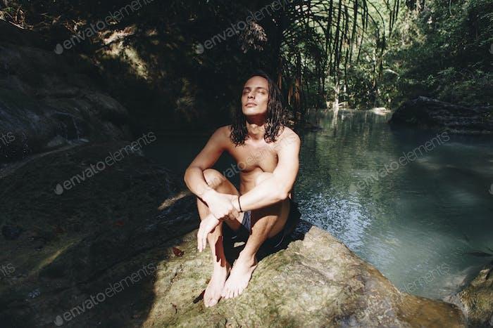 White man enjoying the waterfall