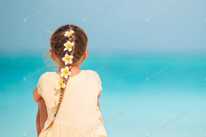 Cute little girl at beach during caribbean vacation
