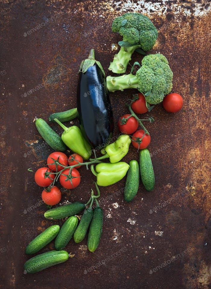 Vegetable mix of garden cherry tomatoes, cucumbers, paprikas, eggplant, broccoli