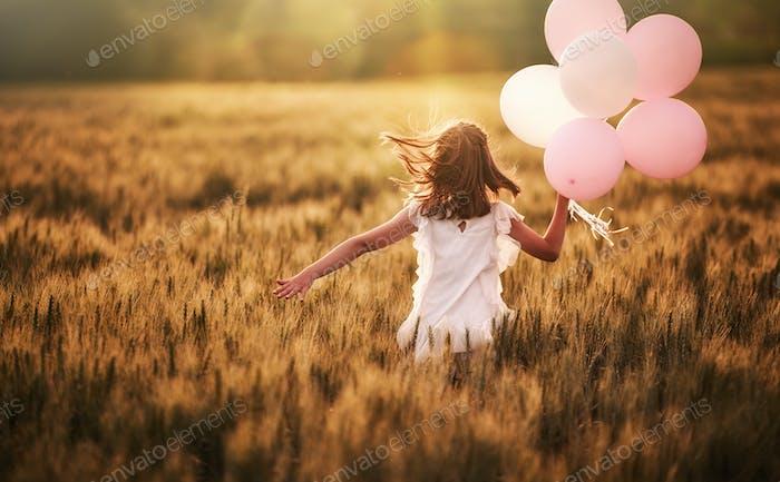 Girl running on cereal field