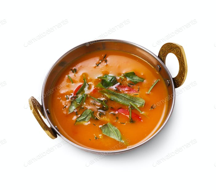 Vegan and vegetarian indian cuisine dish, spicy tomato creamy soup