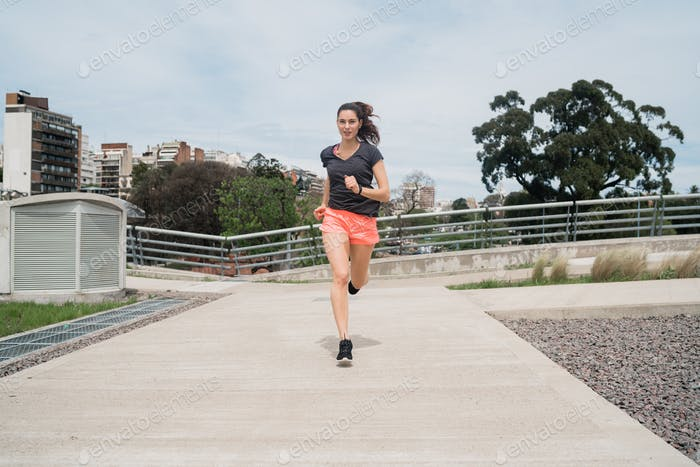 Portrait of fitness woman running.