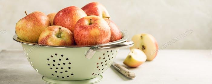 Fresh apples in metal strainer