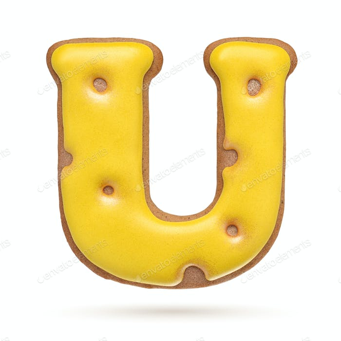 Capital letter U yellow gingerbread biscuit isolated on white.