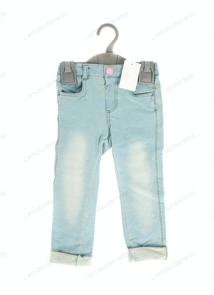 Children blue jeans with blank label.