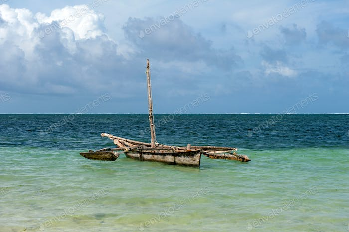 Old wooden dhow, fishing boats in the ocean