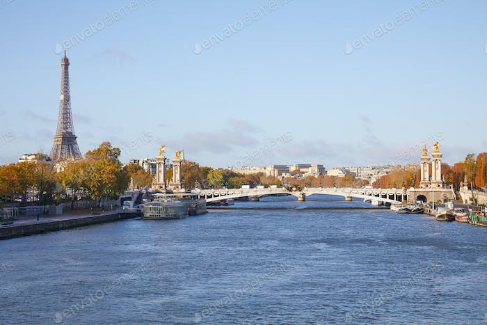 Alexander III bridge, Eiffel tower and Seine river view in a sunny autumn day in Paris, France