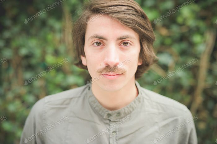 Young handsome caucasian man with moustache