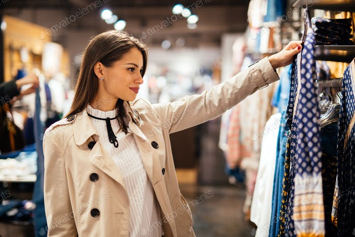 Beautiful young woman buying clothes