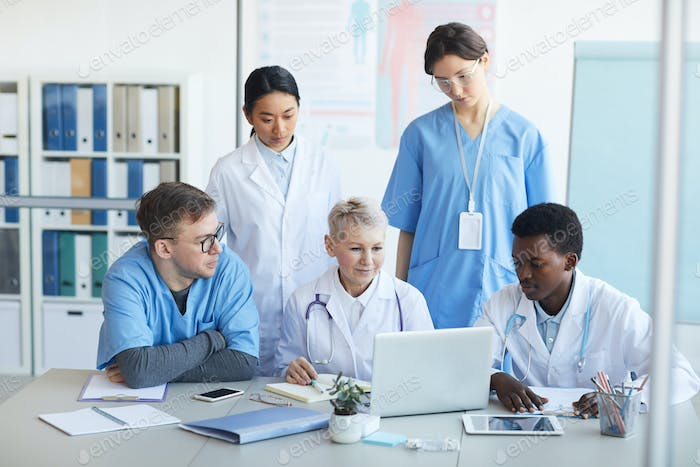 Multi-Ethnic Group of Doctors Working Together