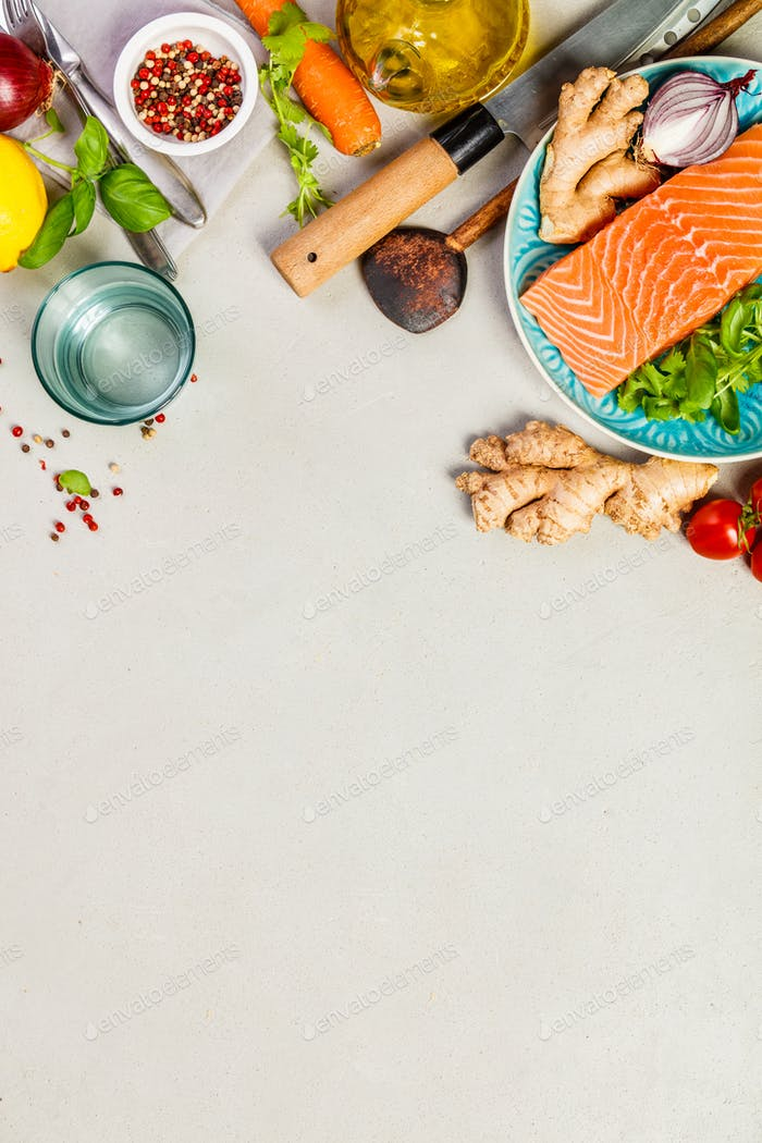 Raw salmon fillet and ingredients for cooking