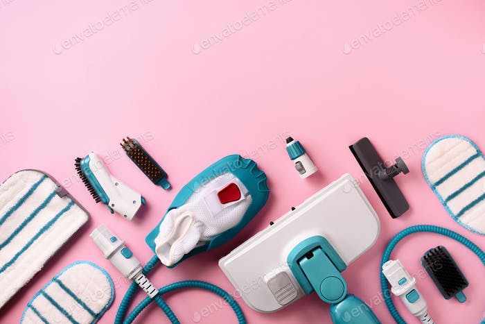 Kit of modern professional steam cleaners on pink background. Top view, flat lay. Banner with copy