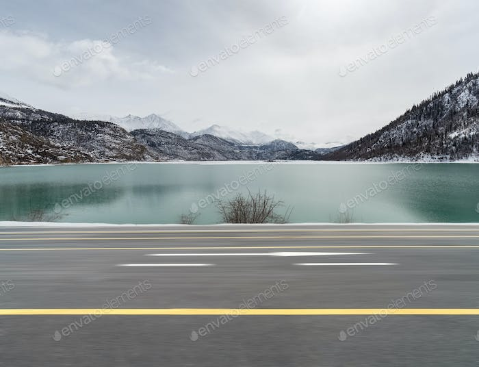 dynamic blur road and snow lake