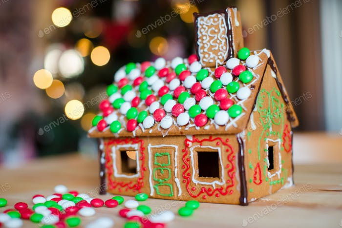Gingerbread cookie and candy ginger house background Christmas tree lights