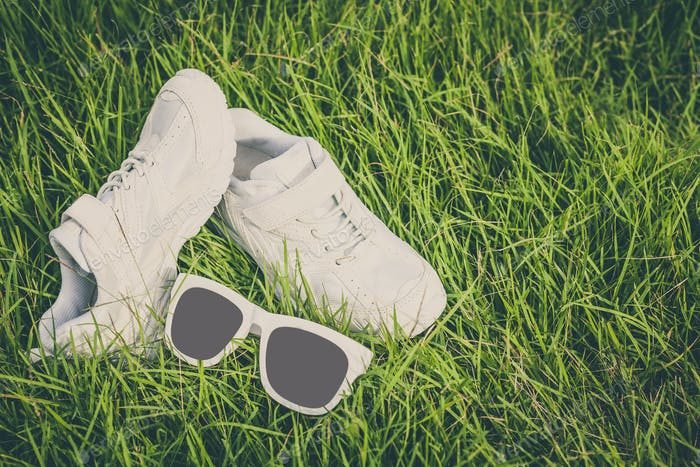 youth sneakers on the grass