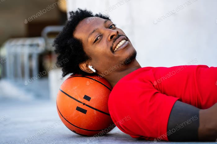 Afro athlete man laying on floor after training.
