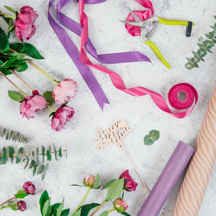 Floristic flat lay with flowers, copy space